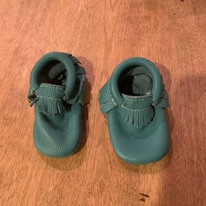 Green freshly picked moccasins